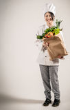 Happy Chef Holding Paper Bag with Fresh Vegetables Stock Photos