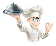 Happy chef holding platter Royalty Free Stock Photography