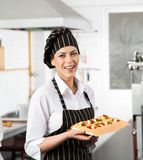 Happy Chef Holding Tray With Stuffed Pasta Sheet Stock Image
