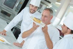Happy chef looking up dish stock photography