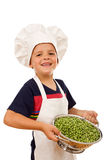 Happy chef with lots of fresh peas Stock Images