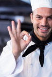 Happy chef making ok sign in commercial kitchen Royalty Free Stock Photos