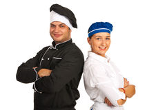 Happy chef male and waitress. Standing back to back with hands crossed royalty free stock photo