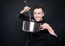 Happy chef man making delicious soup Stock Photography