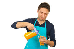 Happy chef man pouring orange juice Stock Photos