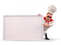 Happy chef pointing towards sign Stock Image