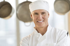 Happy Chef In Restaurant Kitchen Stock Image