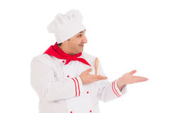 Happy chef showing something wearing red and white uniform Royalty Free Stock Photo