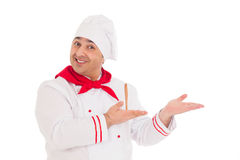 Happy chef showing something wearing red and white uniform Royalty Free Stock Photos