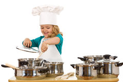 Happy chef stirring soup in a bowl. Happy chef girl stirring soup in a bowl - isolated stock image