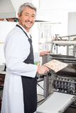 Happy Chef Using Ravioli Pasta Machine At Kitchen Royalty Free Stock Images