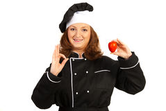 Happy chef woman holding tomato Stock Image