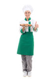 Happy chef woman in uniform holding tray with muffins and thumbs Stock Photo