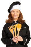 Happy chef woman with wooden utensils Stock Images