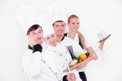 Happy chefs. Young chefs isolated on white Stock Image