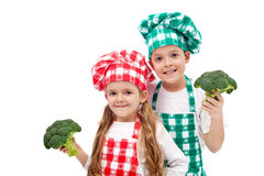 Happy chefs holding broccoli Stock Photo
