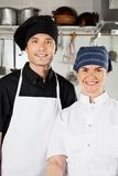 Happy Chefs In Industrial Kitchen Royalty Free Stock Photos