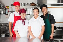 Happy Chefs In Kitchen Royalty Free Stock Photography