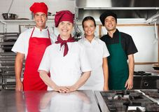 Happy Chefs Standing Together In Kitchen Royalty Free Stock Photos