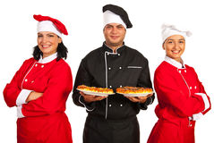 Happy chefs team with pizza Royalty Free Stock Photos