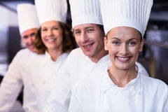 Happy chefs team standing together in commercial kitchen Royalty Free Stock Photography