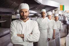 Happy chefs team standing together in commercial kitchen Royalty Free Stock Photo
