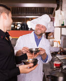 Happy chefs and waiter working Royalty Free Stock Images