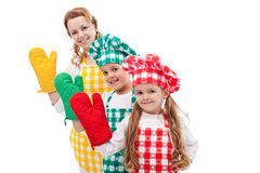 Happy chefs waving with oven gloves Stock Photos