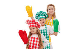 Happy chefs waving to you - kids with large kitchen gloves Royalty Free Stock Image