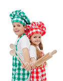 Happy chefs with wooden utensils Stock Photography
