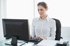 Happy chic businesswoman working on her computer Royalty Free Stock Images