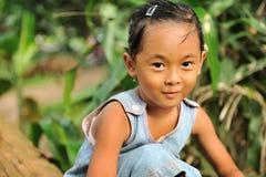 Happy Child. Outdoor portrait of Indonesian village girl Stock Photo