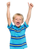 Happy child. Happy young boy has his thumbs up stock image