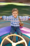Happy child. The happy little girl is turned on a roundabout Royalty Free Stock Photography