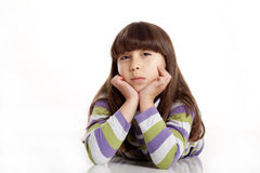 Happy child. Small child poising in a white background Royalty Free Stock Images
