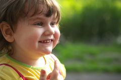 Happy Child. Happy smiling child portrait in nature royalty free stock photo