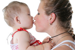 Happy child. Mother plays with the cheerful baby Royalty Free Stock Image