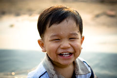 Happy child. Outdoor portrait of a cute little Asian boy child with wet face smiling Stock Image