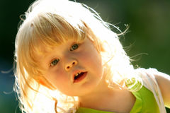 Happy child. In a sun ray Royalty Free Stock Image