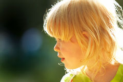 Happy child. In a sun ray Royalty Free Stock Photos