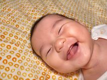 Happy child. A child laughing away after woken up from a nap Stock Image