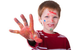 Happy Child. Photo of an adorable child playing with paint. Focus on hand Stock Photo