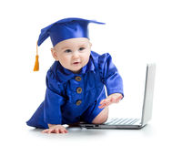 Happy child in academician clothes  with laptop Royalty Free Stock Image