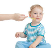 Happy child additonal feeding Royalty Free Stock Photo