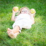Happy child with apples Royalty Free Stock Image