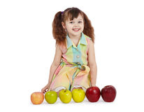 Happy child with apples of different colors Stock Photo