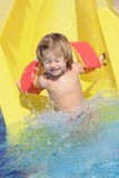 Happy child in aquapark Royalty Free Stock Photos