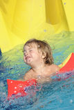 Happy child in aquapark Royalty Free Stock Photo