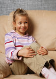Happy child in armchair. Stock Images