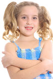 Happy child with arms crossed. Photo of a happy child with arms crossed Royalty Free Stock Image